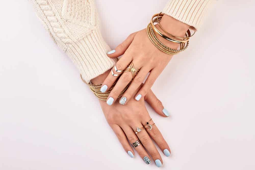 a women hand with silver rings